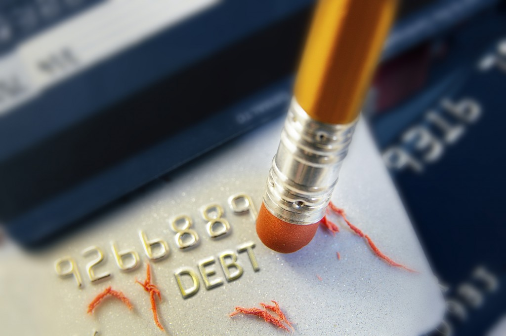 closeup of a pencil erasing credit card debt